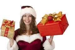 Santa Claus woman holding Christmas gifts Stock Photo