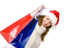 Santa Claus woman holding Christmas shopping bags Royalty Free Stock Photography