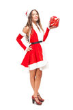 Santa Claus woman holding a gift Stock Image