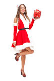 Santa Claus woman holding a gift Stock Photography