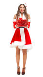 Santa Claus woman holding a gift Stock Photos