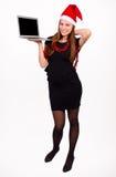 Santa Claus woman holding a laptop Stock Photo