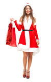 Santa Claus woman holding shopping bags Royalty Free Stock Photo