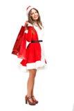 Santa Claus woman holding shopping bags Royalty Free Stock Photos