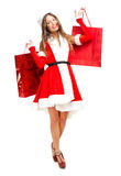 Santa Claus woman holding shopping bags Royalty Free Stock Photography