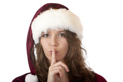 Santa Claus woman with holds finger on mouth Stock Photos