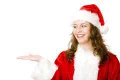 Santa Claus woman hols hand for advertisement sign Royalty Free Stock Photography