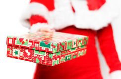 Santa Claus woman offering colored gift box. Close-up of Santa Claus woman offering colored gift box.White background royalty free stock photography