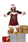 Santa Claus woman presenting Christmas gift boxes Stock Photography