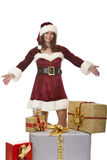 Santa Claus woman presents Christmas gift boxes Stock Images
