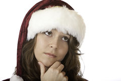 Santa Claus woman thinks on christmas Royalty Free Stock Images