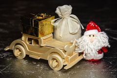 Santa Claus with wooden car, gift box and sack Stock Photo