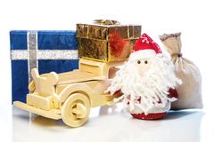 Santa Claus with wooden car, gift boxes and sack Royalty Free Stock Image