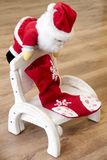 Santa Claus on a wooden chair Royalty Free Stock Images