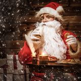 Santa Claus in wooden home interior Royalty Free Stock Photography