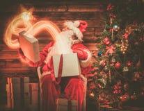 Santa Claus in wooden home interior Stock Photos