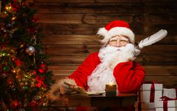Santa Claus in wooden home interior Royalty Free Stock Photos