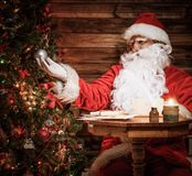 Santa Claus in wooden home interior Stock Photography
