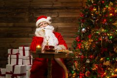 Santa Claus in wooden home interior Royalty Free Stock Images