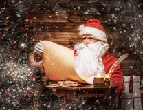 Santa Claus in wooden home interior Stock Images