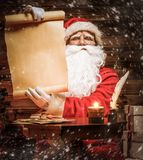 Santa Claus in wooden home interior Royalty Free Stock Photo