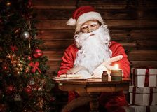 Santa Claus in wooden home interior Stock Photo