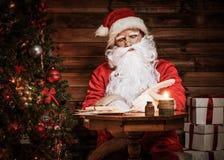 Santa Claus in wooden home interior Stock Photo