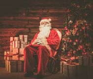 Santa Claus in wooden home interior Royalty Free Stock Image