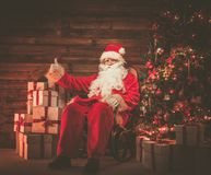 Santa Claus in wooden home interior Stock Photos