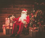Santa Claus in wooden home interior Stock Image