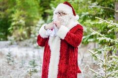 Santa Claus in woods showing quiet secret Stock Photo