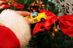 Santa Claus at work. Santa placing a toy circus  beside the  Tree Stock Photography