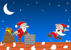 Santa claus at work on a roof meets another santa claus Stock Image