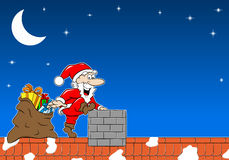 Santa claus at work on a roof Stock Images