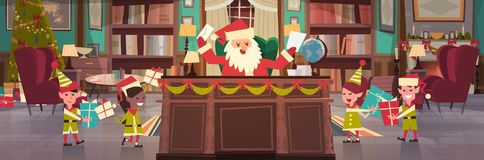 Santa Claus Working With Elfs In Office Room Getting Merry Christmas And Happy New Year Gifts And Presents, Winter Royalty Free Stock Images