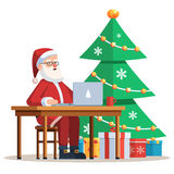 Santa Claus working on laptop Royalty Free Stock Photos