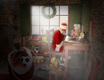 Santa Claus Workshop, Toyshop, North Pole. Illustration of Santa Claus in his workshop or toyshop reading his list of good and naughty boys and girls. Old St Stock Photo