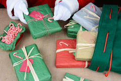 Santa Claus Wrapping Presents Stock Image