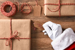 Santa Claus Wrapping Presents Royalty Free Stock Images