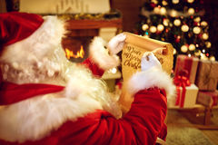 Santa Claus write letter. With goose feather Stock Image