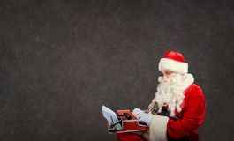 Santa Claus writes a letter on the a typewriter. stock photos