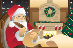 Santa Claus writing Christmas presents list Stock Image