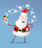 Santa Claus writing letters on the phone. Santa writing letters and answering on the phone Stock Images