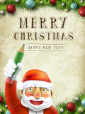 Santa claus writing Merry Christmas Royalty Free Stock Photography