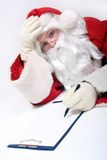 Santa Claus writing a message Stock Photos
