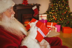 Santa claus writing on a red gift Royalty Free Stock Photo