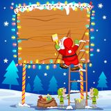 Santa Claus writting Merry Christmas on board Royalty Free Stock Photos