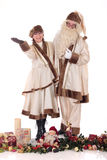 Santa Claus and Xmas woman Stock Photos