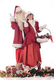 Santa Claus and Xmas woman Stock Photos