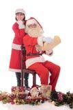 Santa Claus and Xmas woman Stock Images